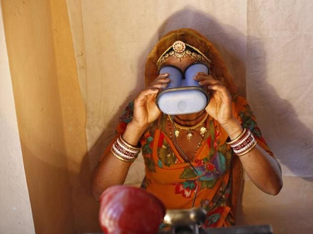 A villager goes through the process of eye scanning for Unique Identification (UID) database system at an enrolment centre at Merta district in the desert Indian state of Rajasthan.