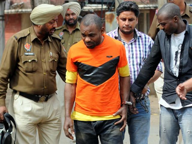 Accused Stanely (left) and Festus Ugochukwu from Nigeria in police custody in Patiala on Friday.