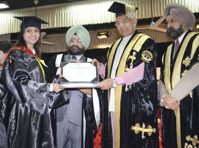 Punjab governor Kaptan Singh Solanki handling over a degree to student during the 42nd Annual Convocation of Guru Nanak Dev University in Amritsar on Friday.