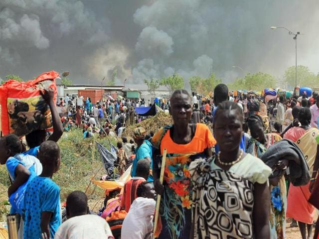 South Sudanese civilians flee fightings in the northeastern town of Malakal on February 18, 2016, where gunmen opened fire on civilians sheltering inside a United Nations base, killing at least five people, the latest in a string of atrocities in the war-torn nation.