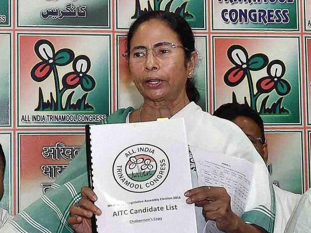 West Bengal chief minister and Trinamool Congress supremo Mamata Banerjee with party leaders during the release of the party's list of candidates for the upcoming Assembly elections, in Kolkata.