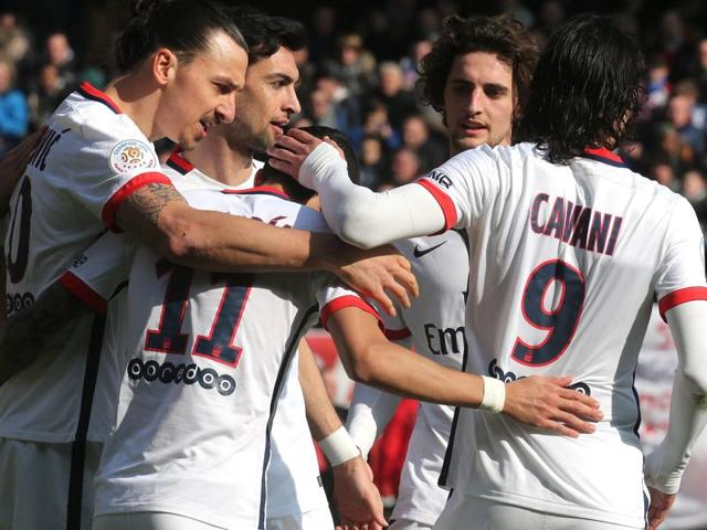 Paris Saint-Germain forward Zlatan Ibrahimovic celebrates with teammates after scoring a goal.