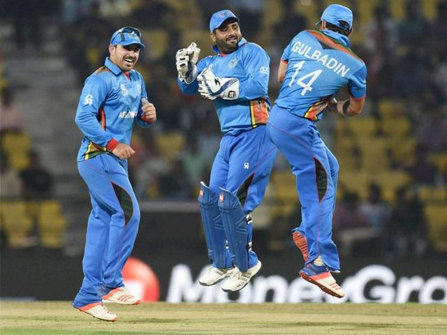 Afghanistan players celebrate their victory against Zimbabwe in the ICC T20 World Cup match in Nagpur on Saturday.
