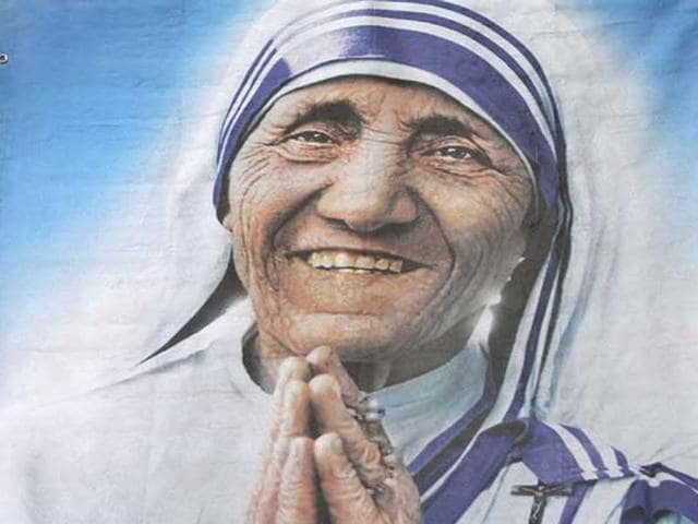 A nun pays tribute to Mother Teresa in Ahmedabad. The Missionaries of Charity founder will be canonised on September 4.