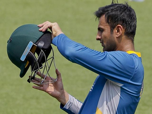 Pakistan's Shoaib Malik adjusts his headgear during a training session ahead of their practice match.