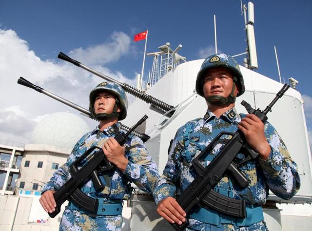 Soldiers of China's People's Liberation Army stand at attention in Beijing. PLA troops have been seen along the Line of Control on the Pakistani side of Kashmir..(REUTERS)