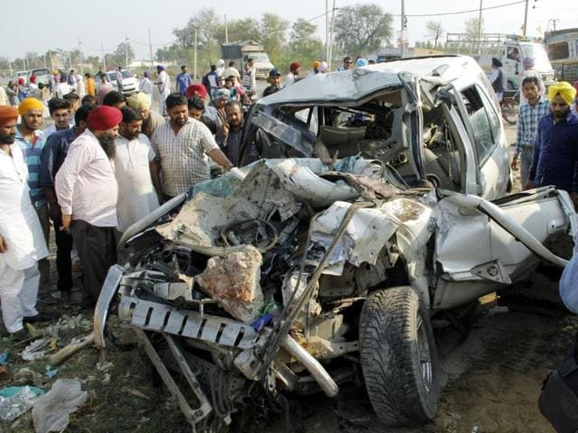 City residents gather around the mangled remains of Tata Safari after accident with a truck near Goniana road on Monday.