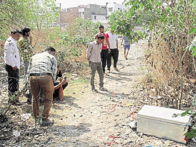 A woman, in her twenties, was found dead in an aluminum box at a green belt near the Raj Nagar railway crossing in Ghaziabad.