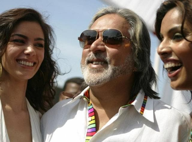 United Breweries group chairman Vijay Mallaya (C) poses with calendar models during the launch of the 'Kingfisher Swimsuit Special Calendar 2007' in Mumbai,.