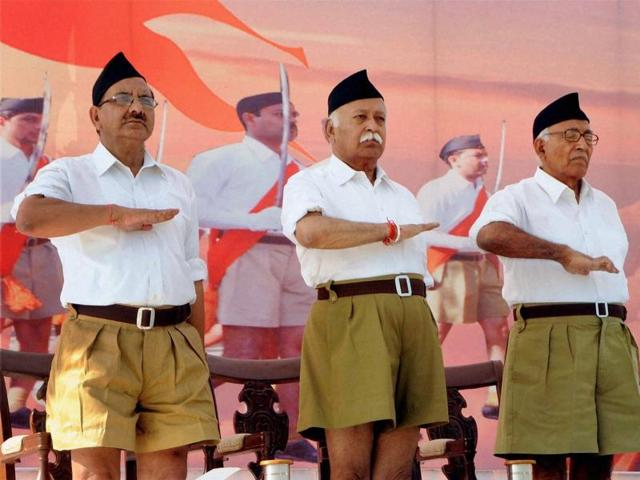 File photo of RSS Chief Mohan Bhagwat (C) during the RSS function. Khaki shorts, the trademark RSS dress for 91 years, is on its way out, making way for brown trousers, the significant makeover decision was taken here at an RSS conclave in Nagaur, Rajasthan on Sunday.