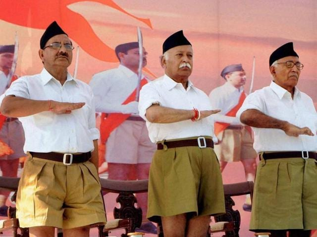 File photo of RSS Chief Mohan Bhagwat (C) during the RSS function. The organisation said on March 13, 2016, that the well-off sections of society should not demand reservation in jobs and education.