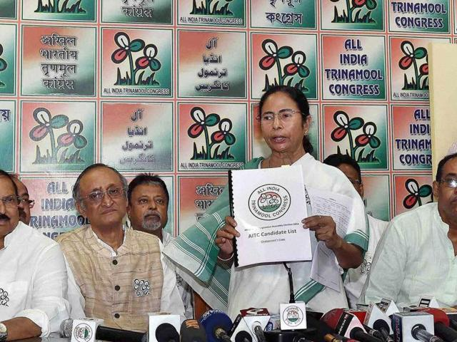 File photo of West Bengal Chief Minister and Trinamool Congress Supremo Mamata Banerjee with party leaders during the release of the party's list of candidates for the upcoming Assembly elections, in Kolkata .