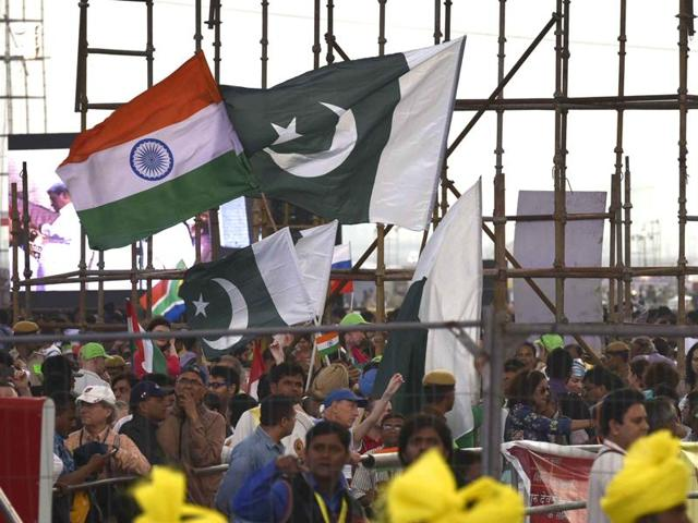 India and Pakistan flags seen during the 2nd day of World Culture Festival at Yamuna River Bank in New Delhi.