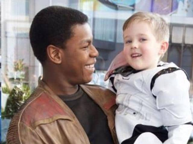 Boyega was joined by a very special fan, 5-year-old Daniel Bell, who has been diagnosed with a brain tumor, and wished to meet Boyega's Star Wars character.