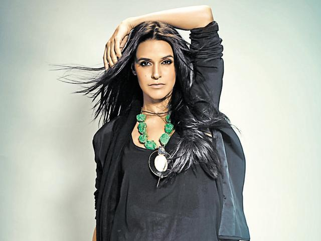 """""""I agree that I had said that I am definitely dissatisfied with my career, but that does not mean that I am unhappy,"""" says Neha Dhupia."""