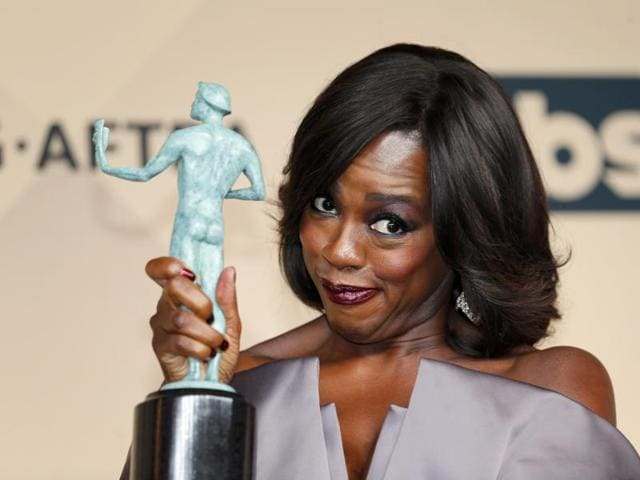 Viola Davis holds the award for Outstanding Performance by a Female Actor in a Drama Series for her role in How to Get Away With Murder during the 22nd Screen Actors Guild Awards.