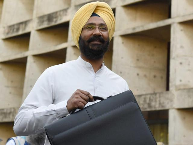 Punjab finance minister Parminder Singh Dhindsa on his arrival to present the budget at the Punjab Vidhan Sabha in Chandigarh on Tuesday.