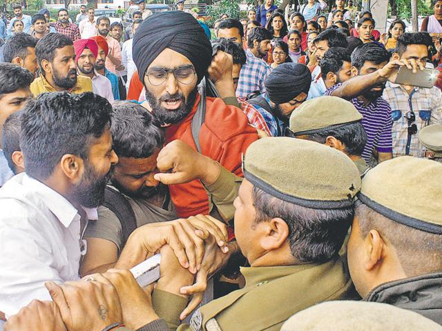 Students clashing with police personnel during the protest against fee hike outside the administrative block at Panjab University on Monday.
