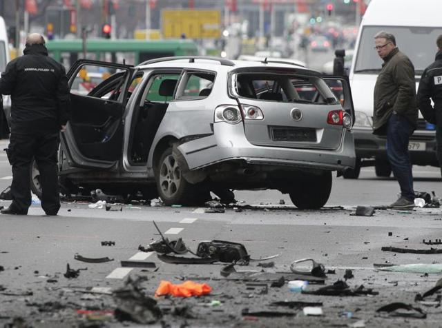 An exploded car sits on a street in Berlin, eastern Germany.