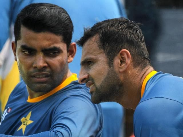 Pakistan's Shoaib Malik and Umar Akmal talk during a break in training session prior to their match against Bangladesh of the ICC World Twenty20 2016 cricket tournament in Kolkata.