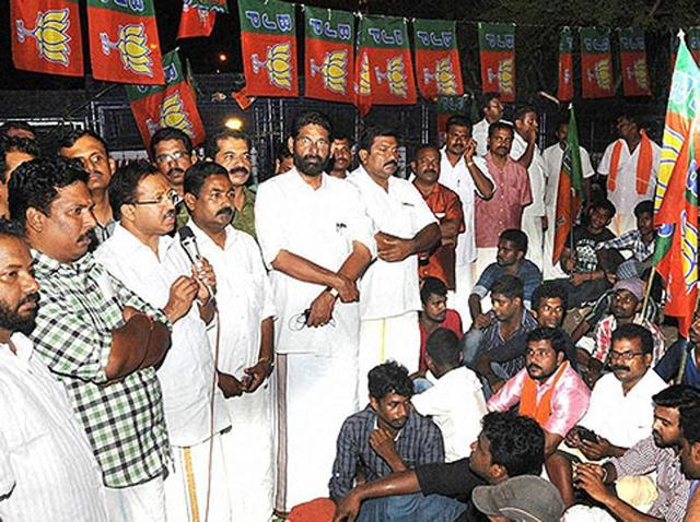 BJP workers hold a meeting outside Kerala assembly inThiruvananthapuram.