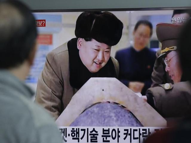 People watch a TV screen showing North Korean leader Kim Jong-Un during a news program, at Seoul Railway Station in Seoul, South Korea.