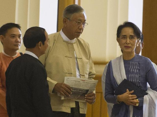 Myanmar lower house parliament speaker Win Myint,  Htin Kyaw (centre) and Aung San Suu Kyi  arrive at the lower house of Parliament in Naypyidaw.