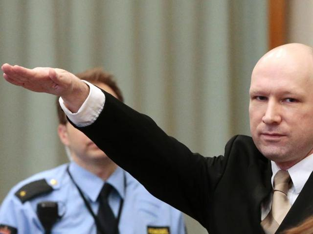 Norwegian mass killer Anders Behring Breivik makes a Nazi salute as he enters the court room in Skien prison.