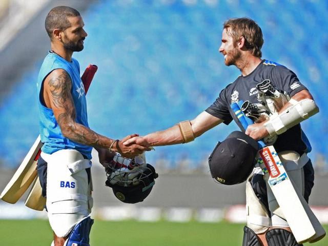 New Zealand's Kane Williamson shakes hands with Shikhar Dhawan during a practice session in Nagpur.