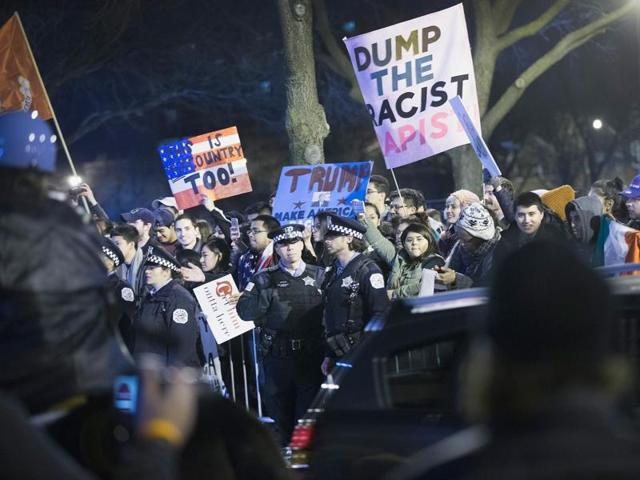 Demonstrators taunt supporters of Republican presidential candidate Donald Trump as they leave a rally at the University of Illinois at Chicago.