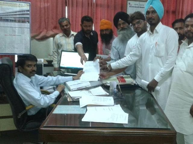 Locals submitting the memorandum to additional deputy commissioner in Sangrur on Tuesday.
