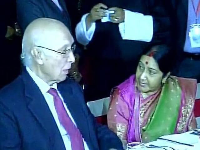 External affairs minister Sushma Swaraj and Pakistani foreign policy chief Sartaj Aziz talk during a dinner hosted by Nepal's Prime Minister KP Sharma Oli.