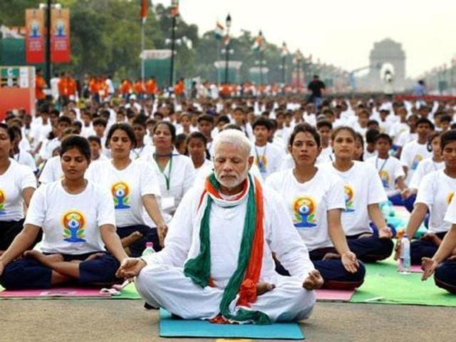 The Prime Minister engages in breathing exercises during last year's World Yoga Day.