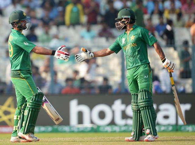 Pakistan's Ahmed Shehzad (L) celebrates with teammate Mohammad Hafeez(R)after scoring a half-century (50 runs) during the World T20.