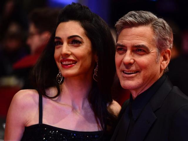 US actor George Clooney (R) and his wife Amal Alamuddin. She will be in India in March to discuss dissent and freedom of expression.