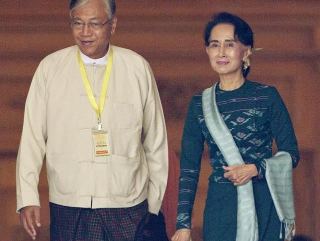 Htin Kyaw, left, newly elected president of Myanmar, walks with National League for Democracy leader Aung San Suu Kyi, right, at Myanmar's parliament in Naypyitaw, Myanmar.