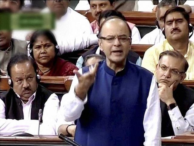 Finance minister Arun Jaitley speaks in Parliament. Jaitley says the UPA's bill on Aadhaar stands altered.