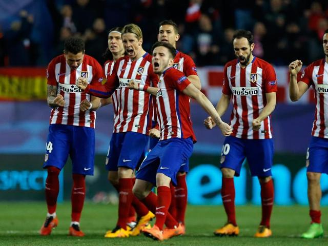 Atletico Madrid's JuanFran Torres scores the winning goal past PSV Eindhoven's goalkeeper Jeroen Zoet during a penalty shootout after extra time in their match.