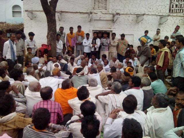 Villagers outside the house of the woman in Tikamgarh.
