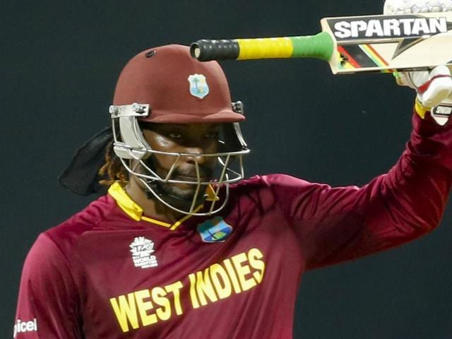 West Indies' Chris Gayle raises his bat after scoring fifty runs against England during their ICC World T20.