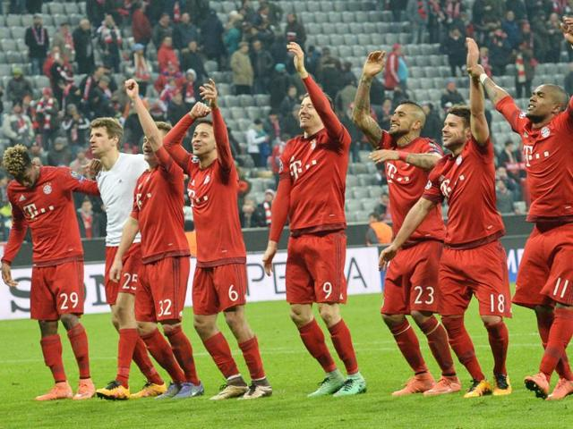 Bayern's Robert Lewandowski celebrates his side's first goal during the Champions League round of 16 second leg match.
