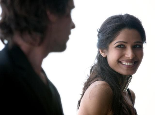 Christian Bale stars as Rick and Freida Pinto as Helen in Terrence Malick's drama Knight Of Cups.