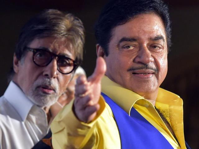 Bollywood actors Shatrughan Sinha and Amitabh Bachhan during the book launch of