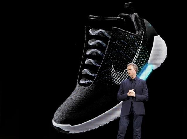 An image of the Nike HyperAdapt 1.0 is projected on a screen as Nike CEO Mark Parker speaks during a news conference, Wednesday.