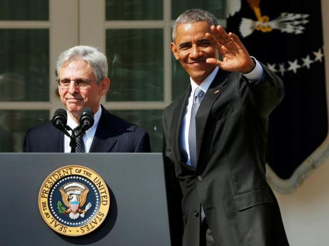 US President Barack Obama waves after Judge Merrick Garland's (L) remarks after announcing Garland as his nominee for the Supreme Court in the Rose Garden of the White House in Washington.