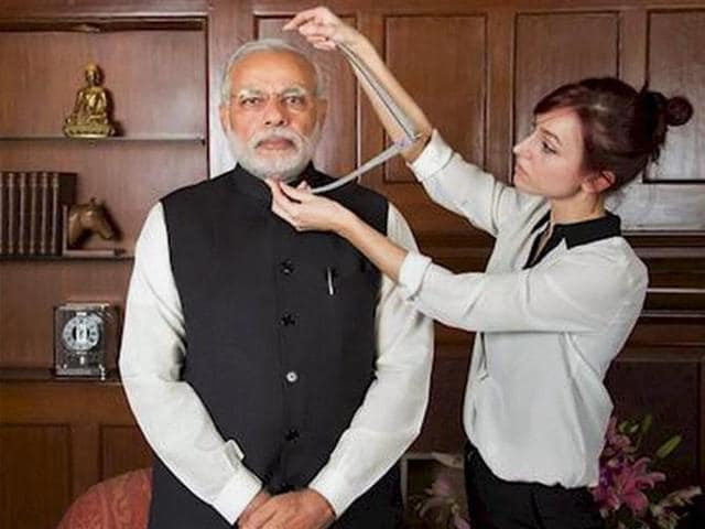 An artist takes measurements of Prime Minister Narendra Modi for his wax statue, in New Delhi on Wednesday.