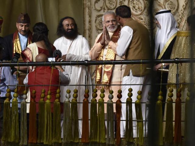 Prime Minister Narendra Modi with Art of Living founder Sri Sri Ravi Shankar during the opening day of the World Culture Festival in New Delhi.(PTI Photo)