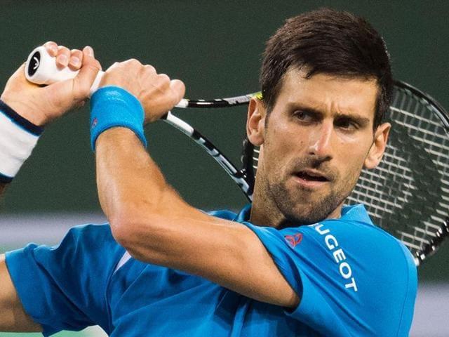 Novak Djokovic of Serbia returns a shot to Feliciano Lopez of Spain.