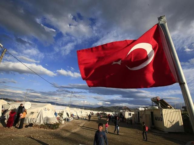 A Turkish flag flies at the refugee camp for Syrian refugees in Islahiye, Gaziantep province.