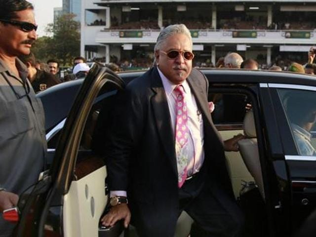 Businessman Vijay Mallya arrives for the Indian Derby 2015 at the Mahalaxmi race course in Mumbai. Mallya has left India after calls for his arrest on charges of money laundering.